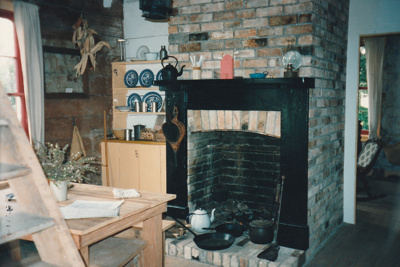 The living room of Sergent Ford's cottage. ; La Roche, Alan; 1995; P2021.51.07