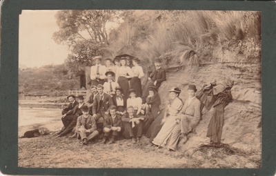 20 men and women picknicking at Howick Beach. May 1894; May 1894; P2021.143.01