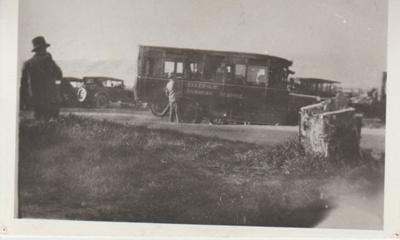 Crawford's motor bus at Howick beach; 1926; 2017.496.64