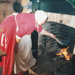 Ros Palmer cooking on an open fire on a Live Day, HHV.  ; 22 August 2006; 2019.196.11