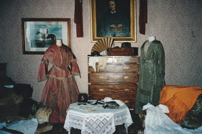 A display of gowns in Puhinui at HHV.; La Roche, Alan; 2003; 2019.229.06