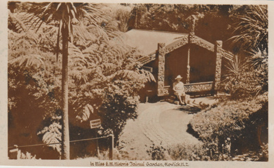 Miss Nixon sitting in front of Torere Ngai Tai.; Breckon, A.N.; 1947; 2019.091.02