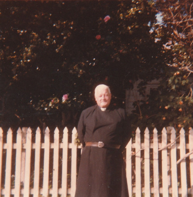 Rev. Robert Hattaway in front of a picket fence, probably at Hawthorn Farm.; 1988; P2021.162.05