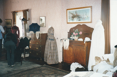 A display of gowns in Puhinui at HHV.; La Roche, Alan; 2003; 2019.229.04