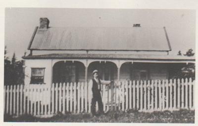 Tommy Mills standing outside 33 Drake Street.; 1922; 2017.656.75