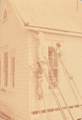 David Mirams, Peter Wren and John Mirams up ladders working on  Pakuranga School at the Howick Historical Village. ; 17 March 1979; P2020.51.09