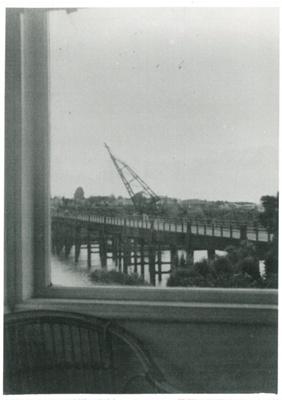 Mahua crane about to demolish Panmure bridge; 1959; 2017.285.22