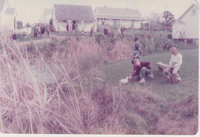 Children feeding a duck near the pond; 1/07/1982; 2019.122.11
