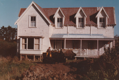 A bulldozer making a road to Puhunui, McLaughlin's Homestead at Howick Historical Village, 1984; JUNE 1984; P2020.08.01