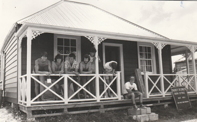 A working party of the verandah of Colonel de Quincey's cottage during restoration at Howick Historical Village.; Eastern Courier; January 1980; P2020.112.02