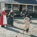 Ros Palmer (left) and Lois Abram with school children stilt walking in Howick Historical Village.; La Roche, Alan; P2021.125.03