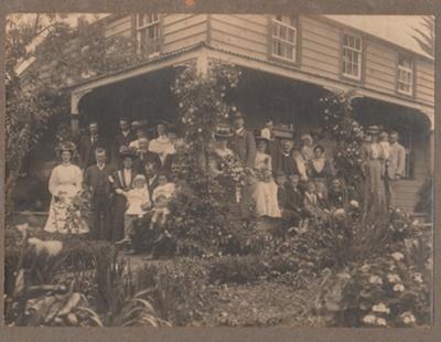 A family wedding party on the verandah of the Cascade Homestead; 1/11/1908; 2018.094.02