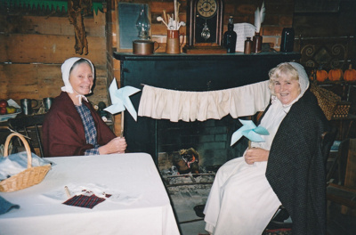 Adrienne Zuppicich and Margaret Robinson holding windmills in Briody-McDaniel's cottage on a Live Day.; La Roche, Alan; P2020.104.12