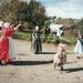 Ros Palmer (left) and Lois Abram with two schoolgirls stilt walking in Howick Historical Village.; La Roche, Alan; P2021.125.04
