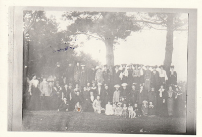 A group of people in Picton Street probably celebrating the first fun of Gilmour's bus.; 1905-6; P2021.136.01