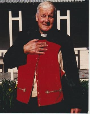 Robert Hattaway holding his Great Grandfather's military waistcoat; 2018.364.17
