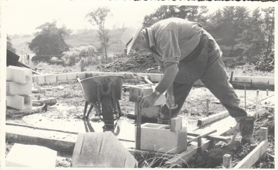 Arthur White laying the foundations for the Coachhouse in the Howick Historical Village.; Groethe. Julia; 1975; P2021.23.01