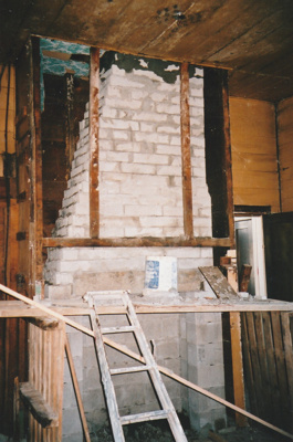 The fireplace in Puhinui kitchen under construction by Gary McCarthy.; Alan La Roche; September 2003; P2020.14.15