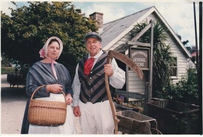 Doug White and his sister, Brenda Scott, descendants of james White outside White's Store.; Eastern Courier; P2020.89.05