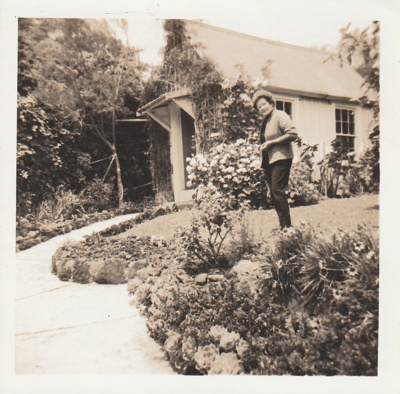 A lady in the garden surrounding the old Remuera School (Dame School) near the Bishop family home in Manawa Road, Remuera. ; Cathie, Keith; P2021.58.03