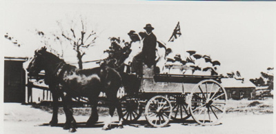 A horse-drawn wagon full of children; 2017.422.01