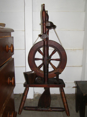 Traditional wooden spinning wheel.