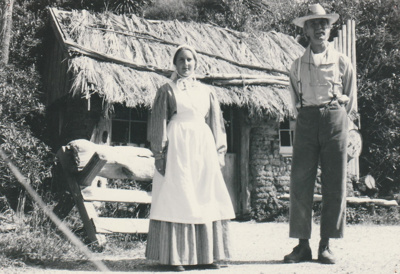 A lady and man in costume outside the Sod Cottage, Howick Historical Village on a Live Day.; La Roche, Alan; February 1992; P2020.45.03