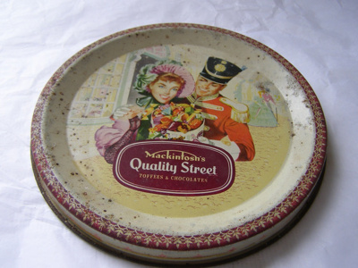 Painted metal container. Candy tin. Inscription on...