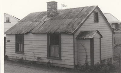 Maher-Gallagher Cottage, formerly Carter Cottage, in position at the Howick Historical Village.; Eastern Courier; September 1980; P2020.95.06