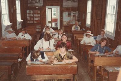 Children at their desks in Ararimu Valley School in the Howick Historical Village. ; La Roche, Alan; P2020.21.14