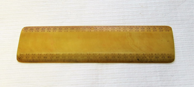 Small bone ruler. Markings on the side as well as ...