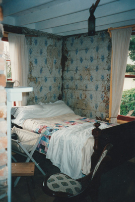 The bedroom of Sergent Ford's cottage. ; La Roche, Alan; 1995; P2021.51.09