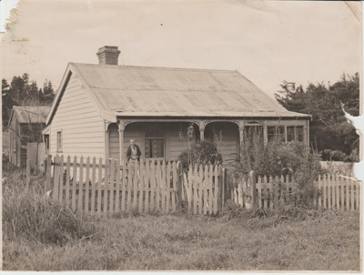 Mrs Smith standing on the verandah at her home in Moore Street; Breckon, A.N., Northcote; c1920; 2017.644.63