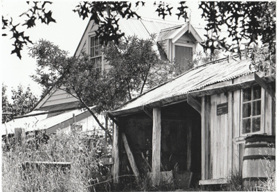 Somerville's cow shed in front of  the Coachhouse in the Howick Historical Village. ; Eastern Courier; P2021.25.01