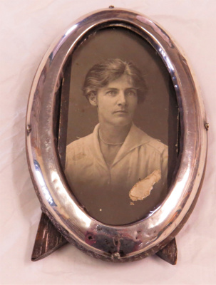 Oval shaped Silver frame with photograph of Katie ...