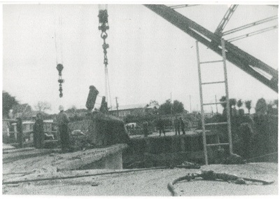 Mahua crane demolishing Panmure bridge; 1959; 2017.285.25