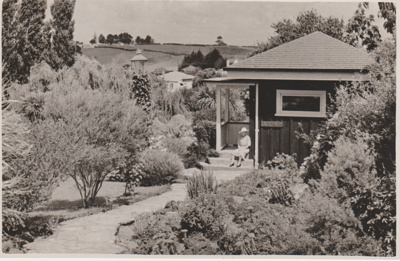 Miss Nixon sitting in front of her home.; Breckon, A.N.; 1947; 2019.091.03