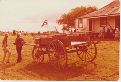 Open day at the Howick Historical Village showing a cart in front of Eckfords cottage.; 7/04/1979; 2019.100.09