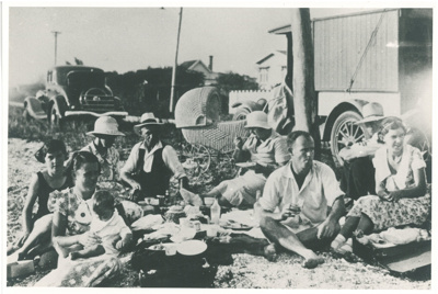 White family having a picnic at Bucklands Beach White family picnic at Bucklands Beach; Fairfield, Geoff; c1933; 2016.610.09