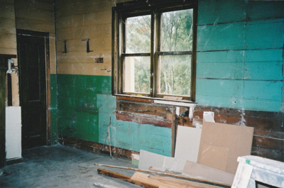 Puhinui kitchen before restoration, showing a door, window and walls.; Alan La Roche; May 2002; P2020.14.02