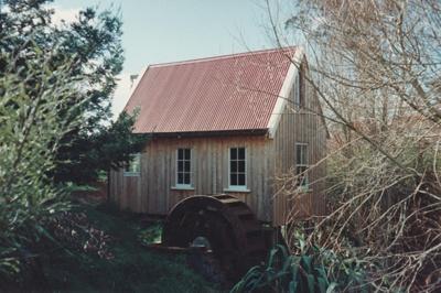 Bycroft's flour mill and water wheel in Howick Historical Village.; La Roche, Alan; 1992; P2021.86.10