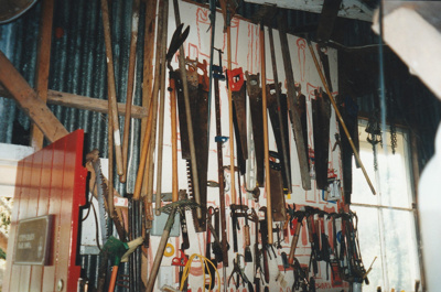 Collection of saws in Udy's Barn in Howick Historical Village.; La Roche, Alan; 2003; P2021.46.07