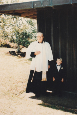 Rev Robert Hattaway and a small boy at St John's Church, East Tamaki.; Clarke Photography, Howickville; 15 December 1990; P2018.364.14