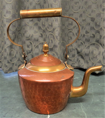 Copper kettle - with brass handle. Beaten copper m...