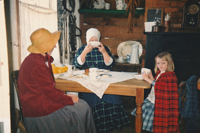 Adrienne Zuppicich and two others in Briody-McDaniel's cottage on a Live Day.; La Roche, Alan; P2020.104.13
