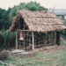 The mail runner's cottage showing the framework under construction at Howick Historical Village. A window has been installed.; La Roche, Alan; June 1992; P2021.83.30