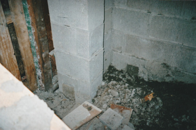 The fireplace in Puhinui kitchen under construction by Gary McCarthy.; Alan La Roche; September 2003; P2020.14.16