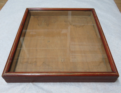 Shallow Display case made of wood with a glass top...