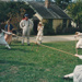 Devlin Bishop watching  the village urchin girls in costume, playing with a rope in Howick Historical Village.; May 1994; P2021.124.03
