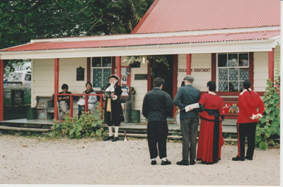 Ron Fryer, as the Town Crier welcoming a couple into Brindle Cottage.; 2019.132.07